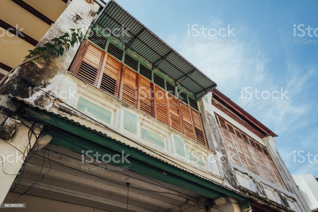 Abandoned chinese colonial old building facade in George Town. Penang, Malaysia. stock photo