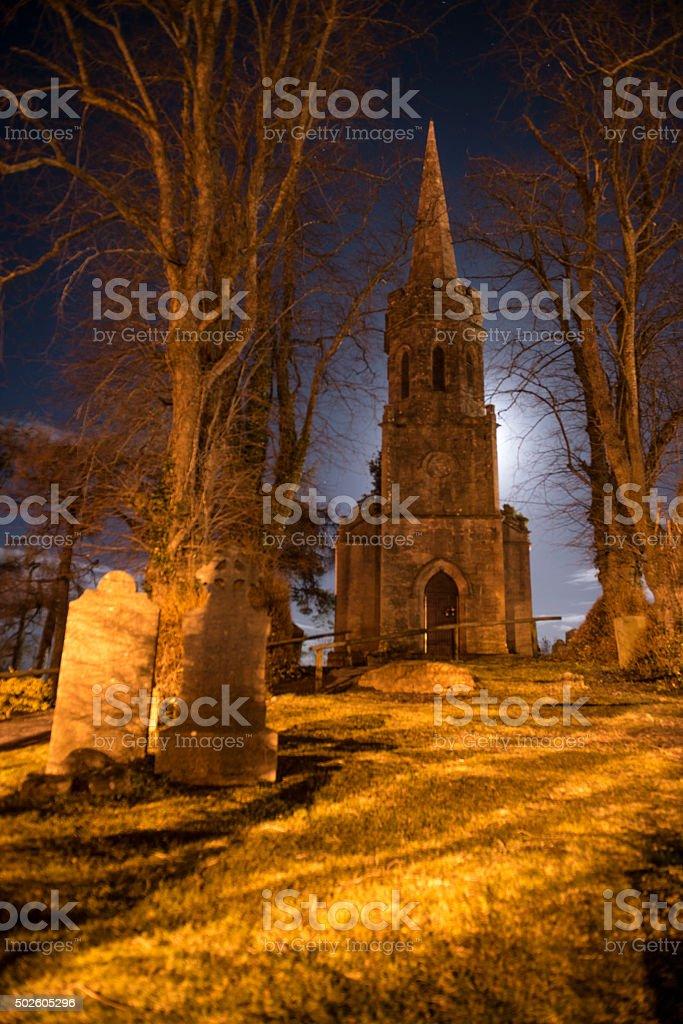 Abandoned Church and graveyard at night stock photo