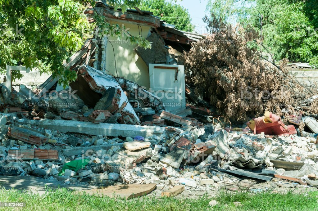 Abandoned civilian house in East Ukraine damaged by grenade explosion in the war zone stock photo