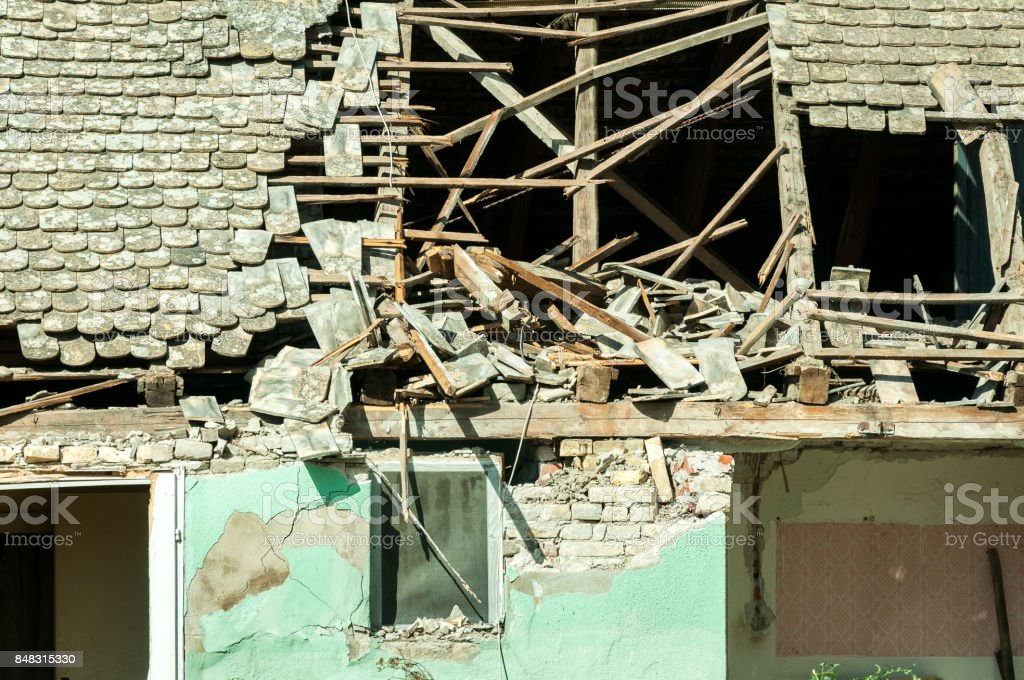 Abandoned civilian house in Eastern Ukraine damaged by grenade explosion in the war zone stock photo