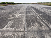 Abandoned concrete airfield / airport runway