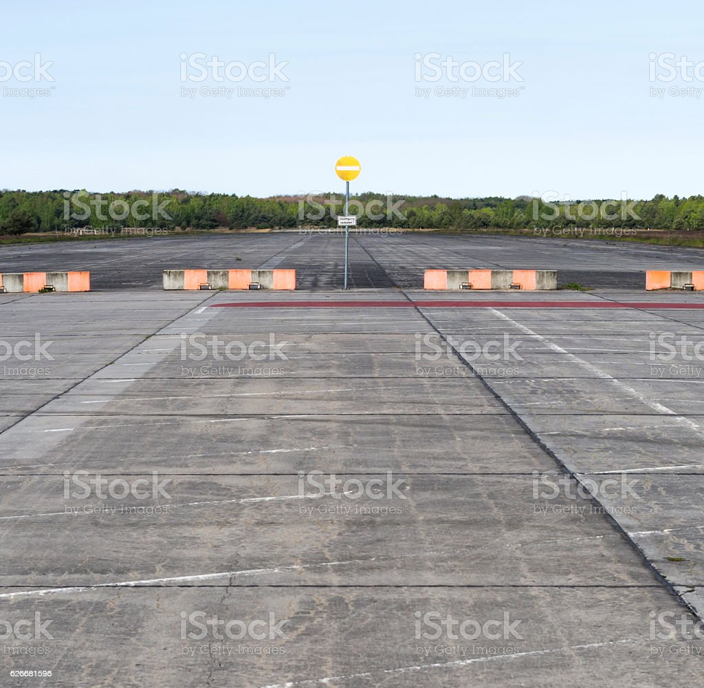 Abandoned concrete airfield / airport runway stock photo