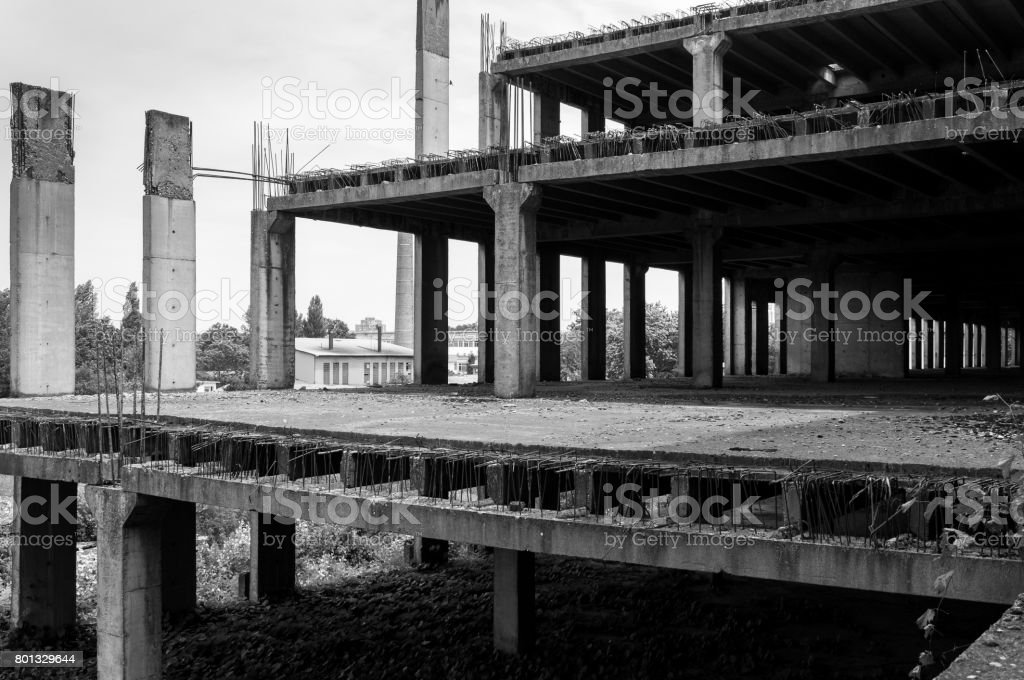 Abandoned construction site building. Abandoned place. Building skeleton. Black and white. stock photo