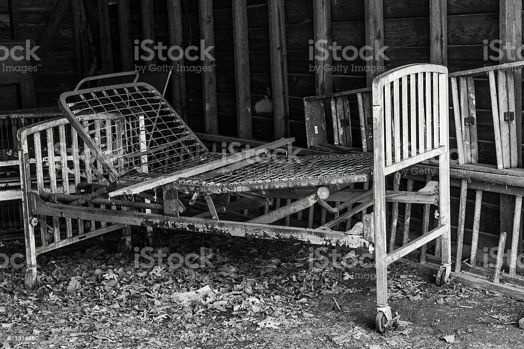 Abandoned cots and beds stock photo