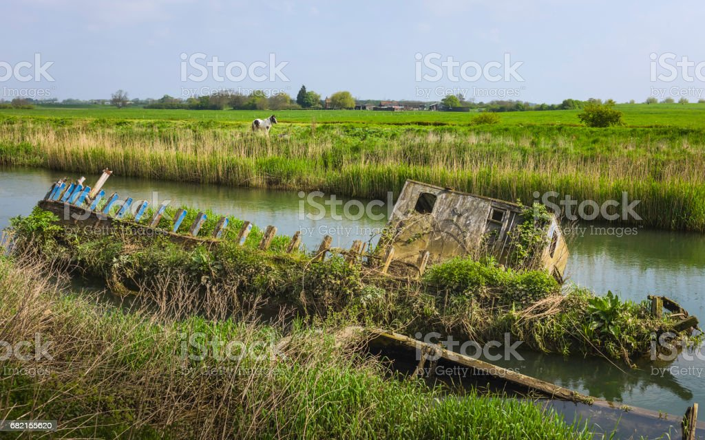 Abandoned derelict boat on river Hull, Beverley, Yorkshire, UK. stock photo