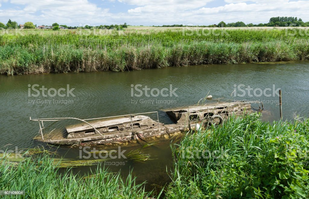 Abandoned derelict plywood shuttering in front of river jetty. stock photo