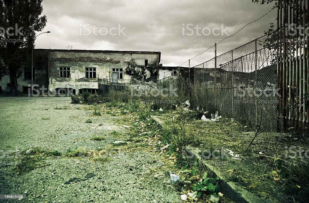 Abandoned Factory and garbage. Crisis. Disaster. Grunge. royalty-free stock photo