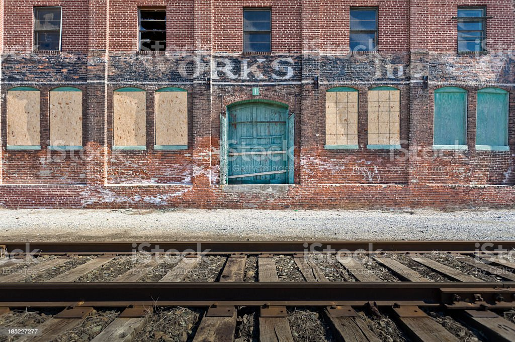 Abandoned Factory by Railroad Tracks royalty-free stock photo