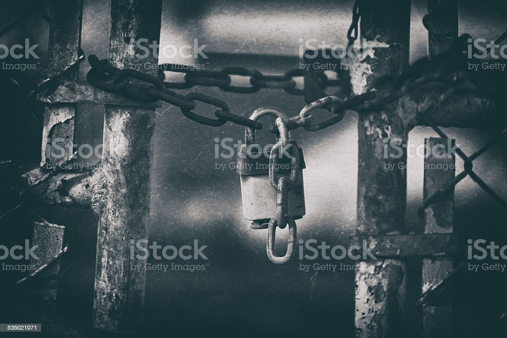 Abandoned Factory Gate Lock with Grunge Effect stock photo