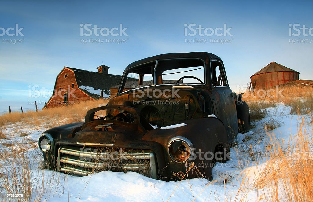 Abandoned Farm and Rusty Truck in Winter stock photo
