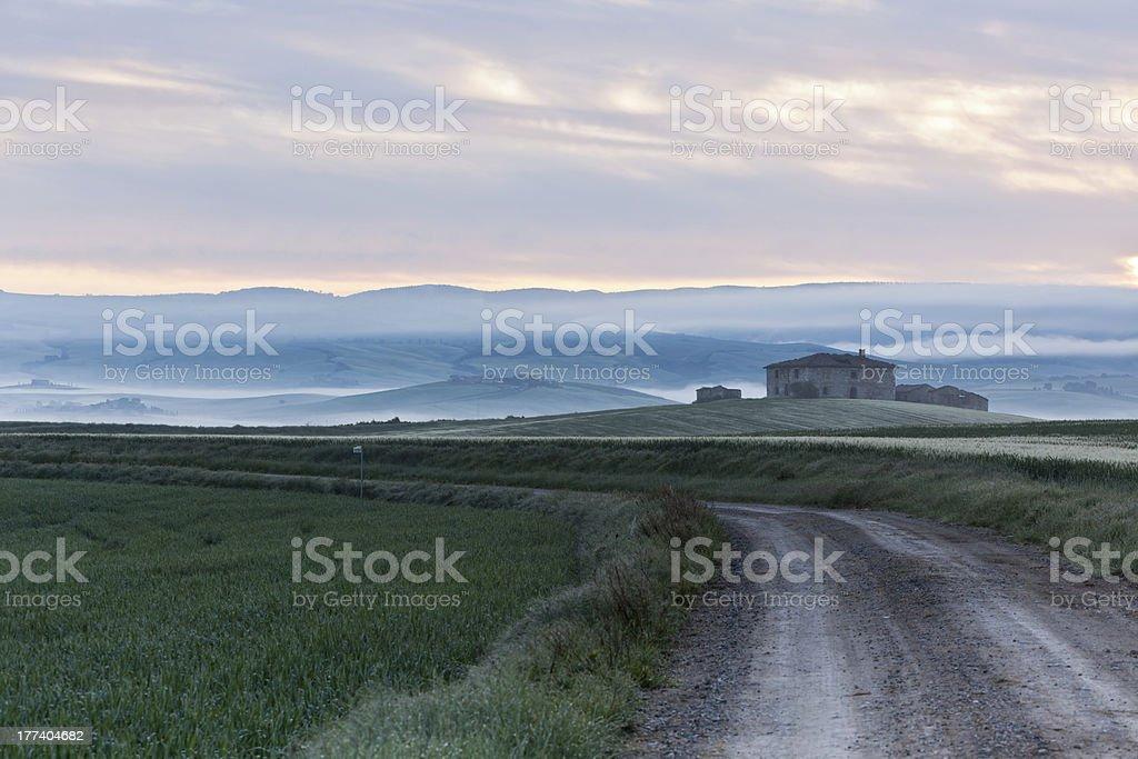 Abandoned farmhouse in Tuscany at sunrise royalty-free stock photo