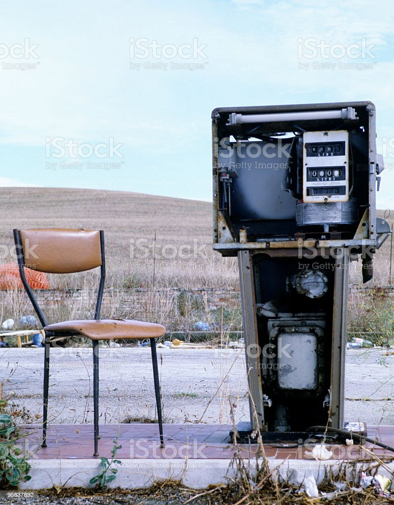 Abandoned Gas Station and Vintage Chair.Rural Scene royalty-free stock photo