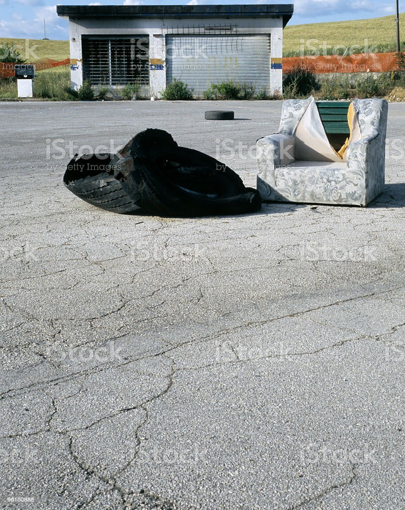 Abandoned Gas Station with Damaged Armchair stock photo