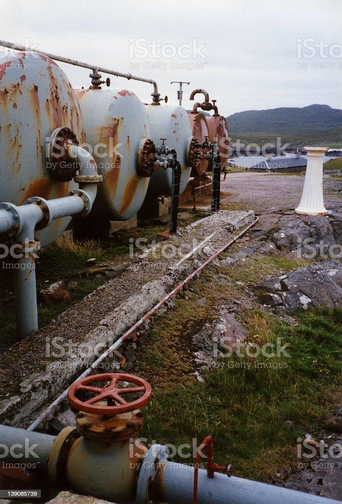 Abandoned gas tanks royalty-free stock photo