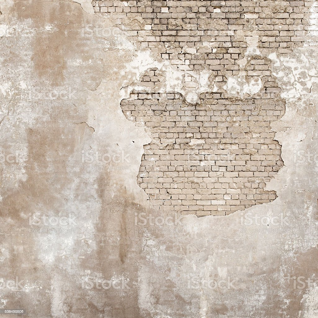 abandoned grunge cracked brick stucco wall stock photo