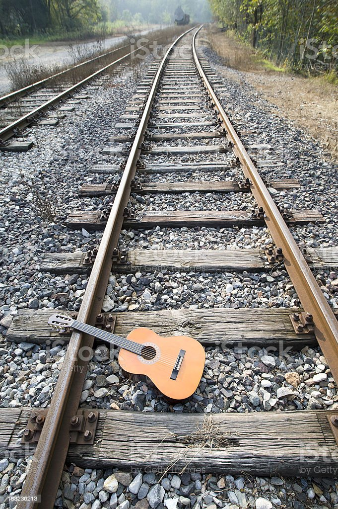 Abandoned Guitar On The Railway stock photo