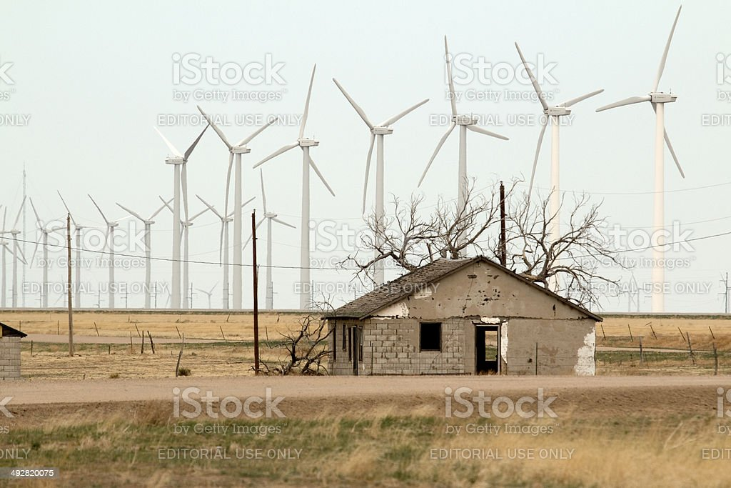 Abandoned home and GE wind turbines southeast Colorado stock photo