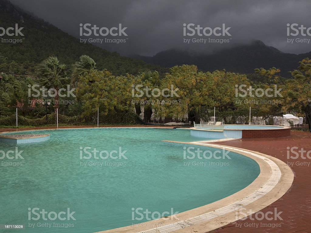 Abandoned Hotel Pool Captured During a Storm royalty-free stock photo