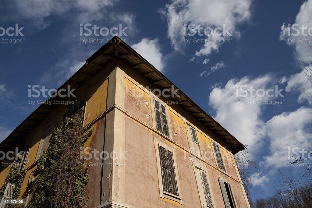 Abandoned House Against a Blue Sky stock photo