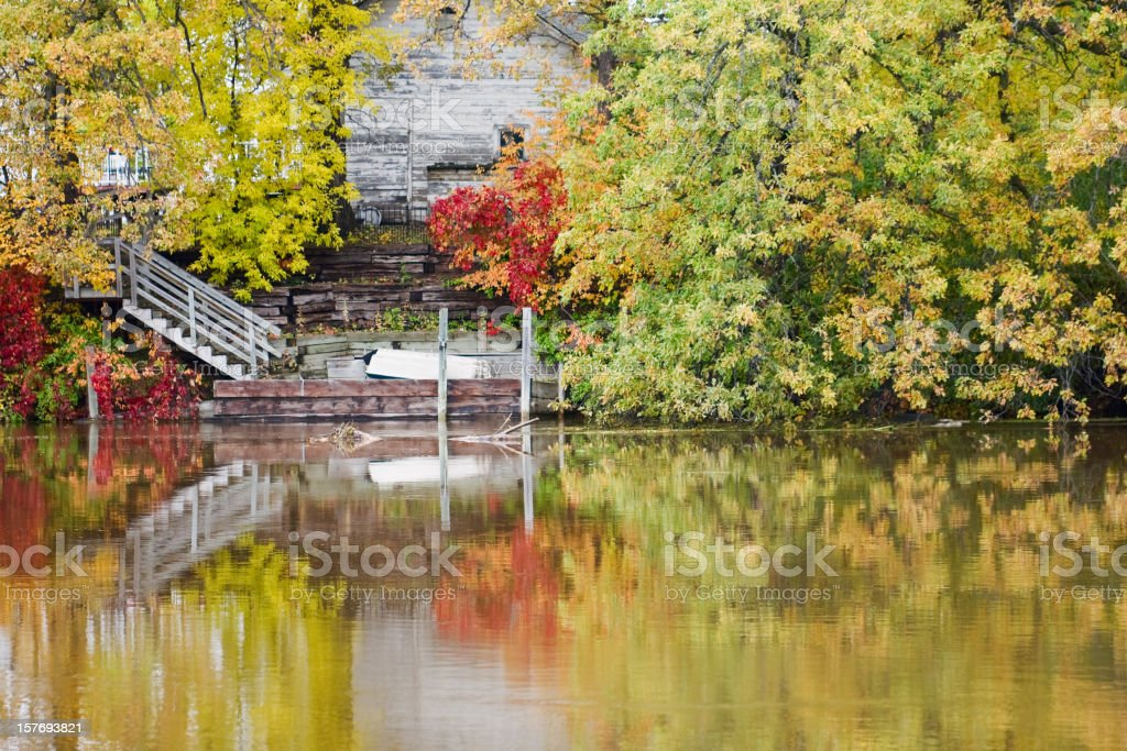 Abandoned House and Autumn Foilage Reflected in River royalty-free stock photo