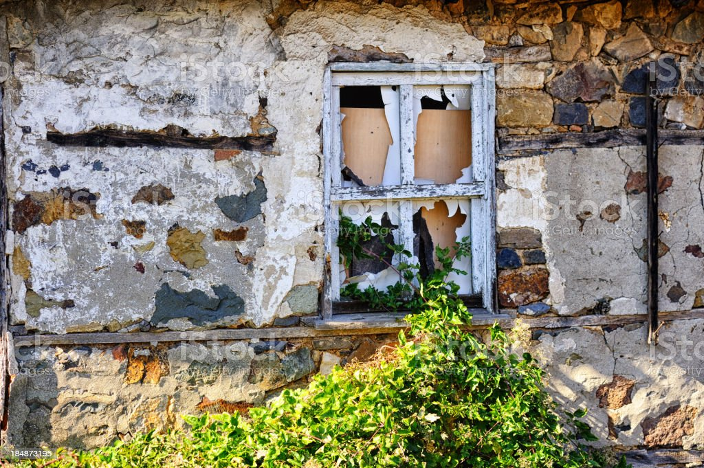 Abandoned house as a result of assimilation campaign stock photo