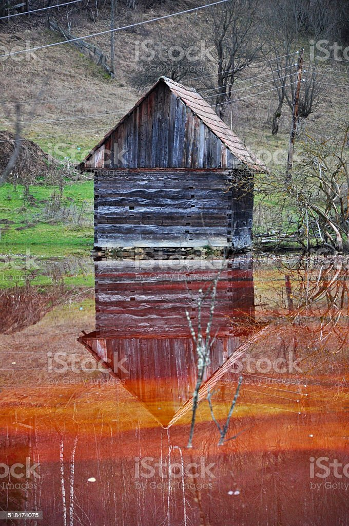 Abandoned house flooded in a lake stock photo