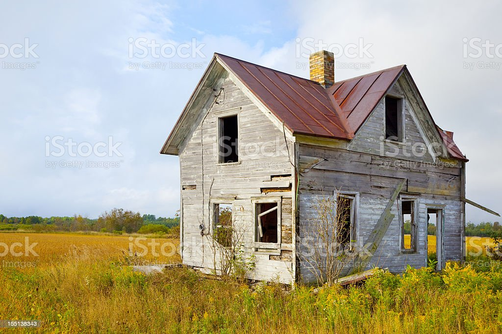 Abandoned House in Golden Autumn Field royalty-free stock photo