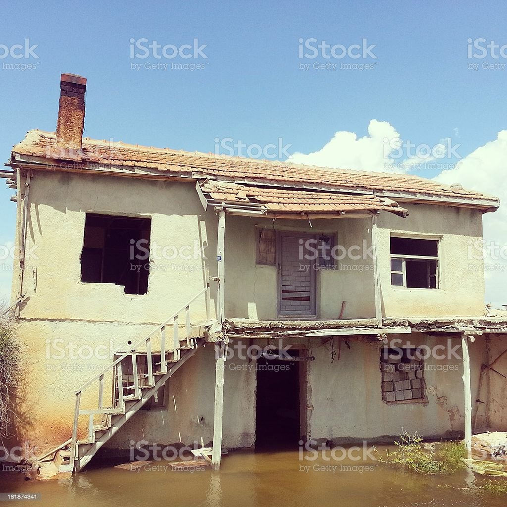 Abandoned house in water stock photo