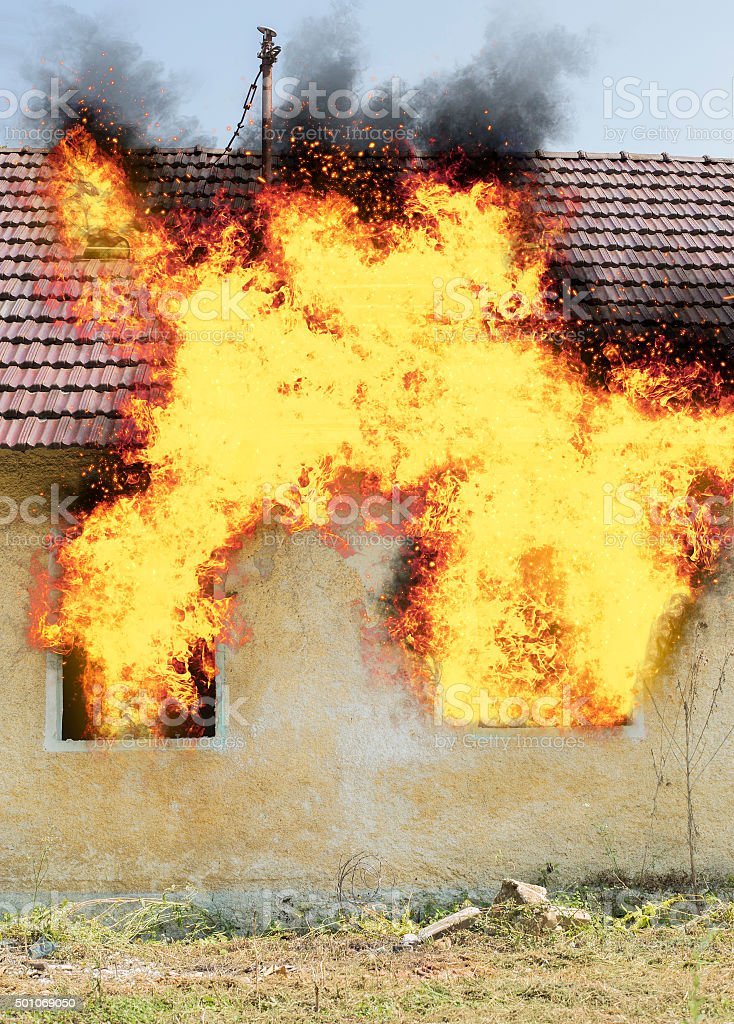 Abandoned house on fire stock photo