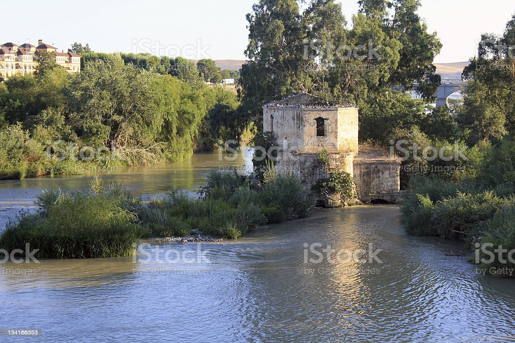 Abandoned house on the river stock photo
