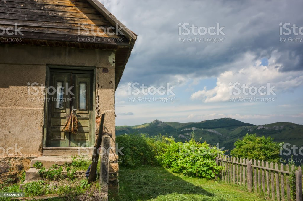 Abandoned house somewhere in the hills stock photo