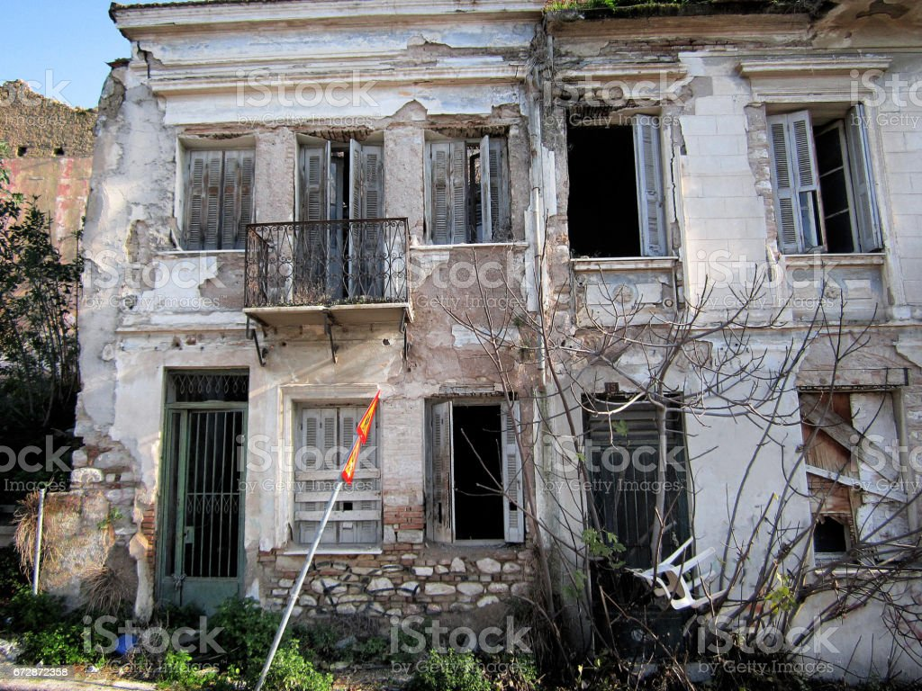 Abandoned house with boarded-up windows stock photo