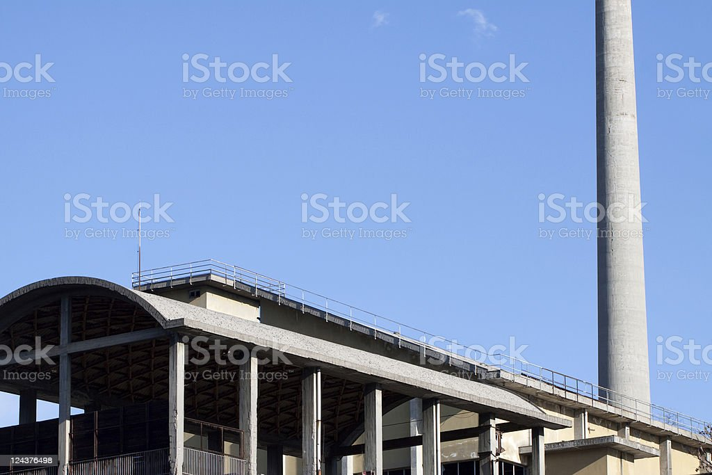 Abandoned Industrial Factory Against a Blue Sky, Copy Space stock photo