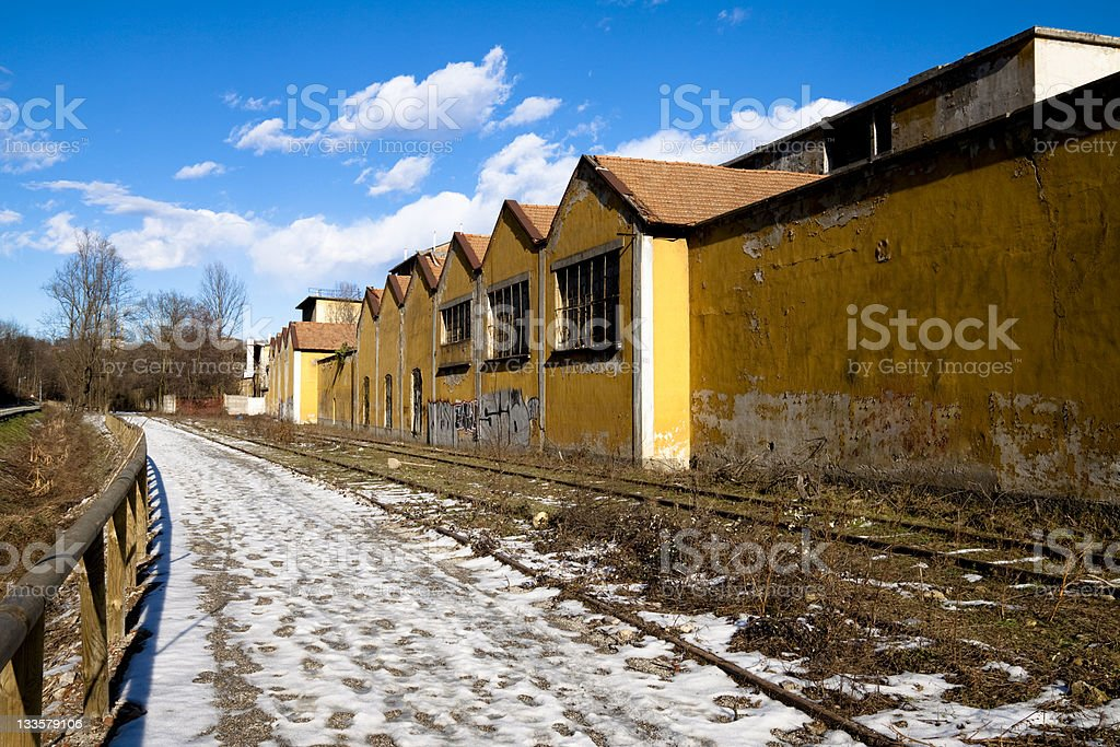 Abandoned Industrial Factory Against a Blue Sky stock photo
