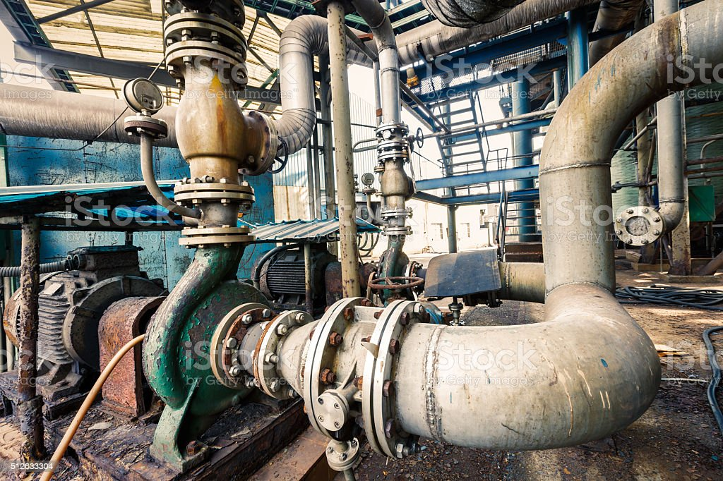 abandoned industrial pipeline equipment in a old steel mills stock photo