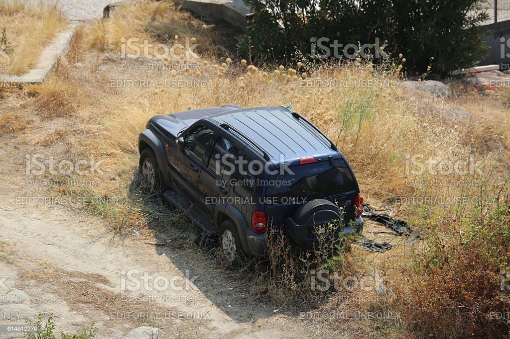 Abandoned Jeep Cherokee SUV in a Field stock photo