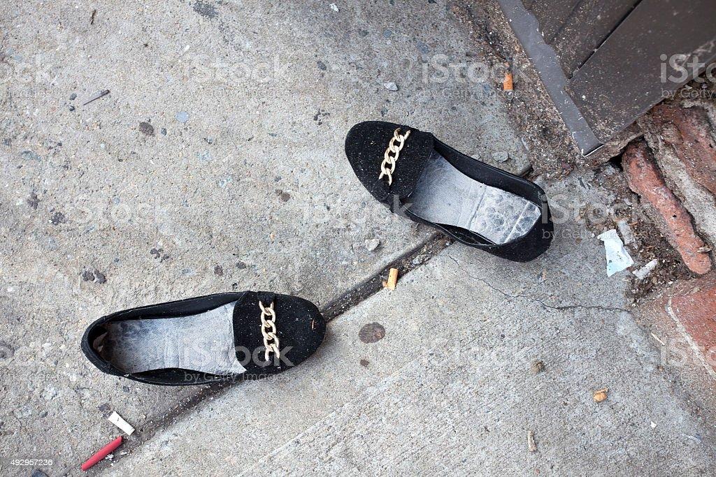 Abandoned Ladies Dress Shoes stock photo