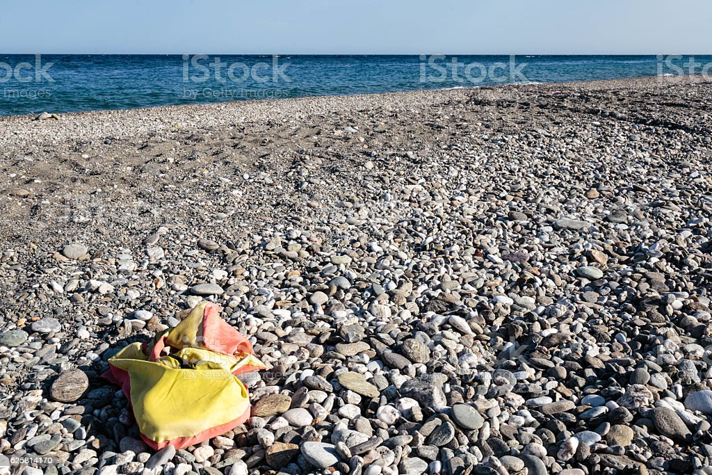 Abandoned lifevest on a beach in Sicily stock photo