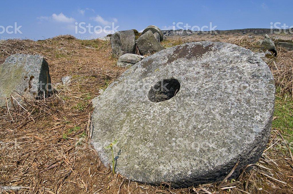 Abandoned Millstones stock photo
