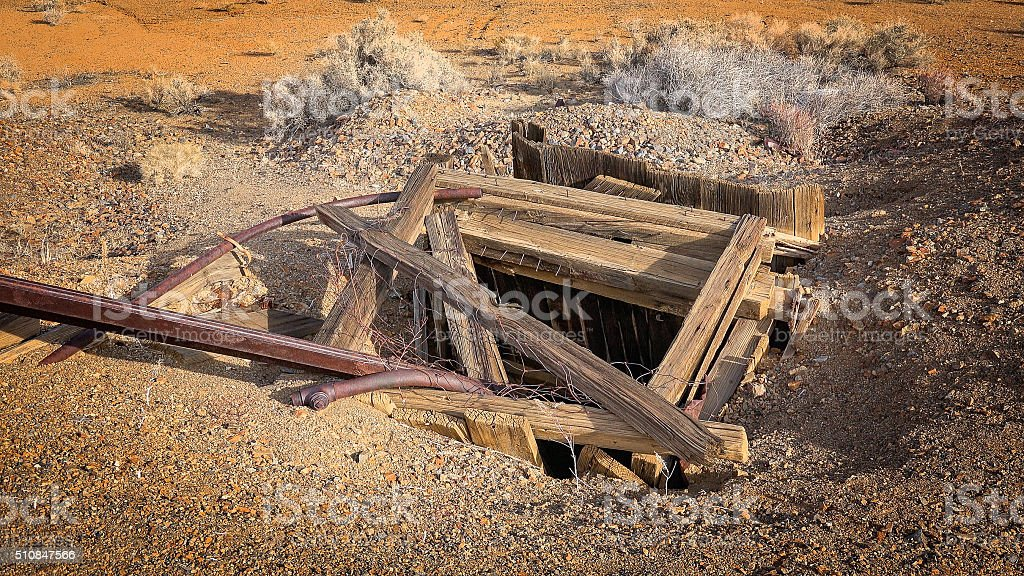Abandoned Mine Shaft in Western Gold Rush Town stock photo