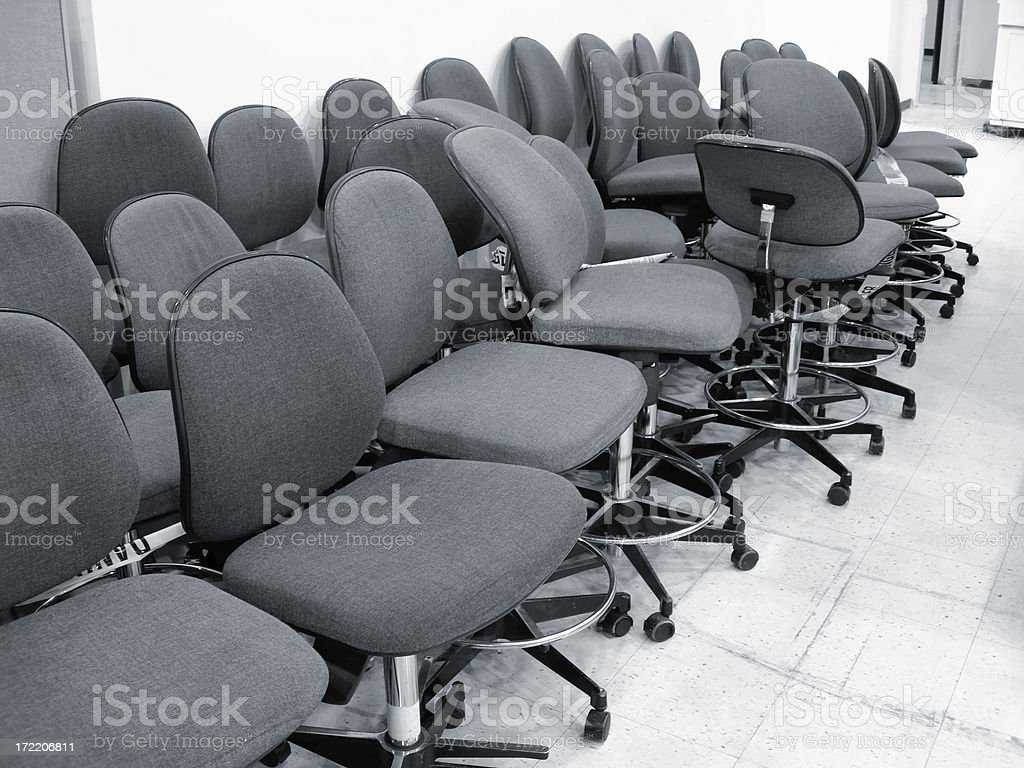 Abandoned office chairs in a closing industry royalty-free stock photo