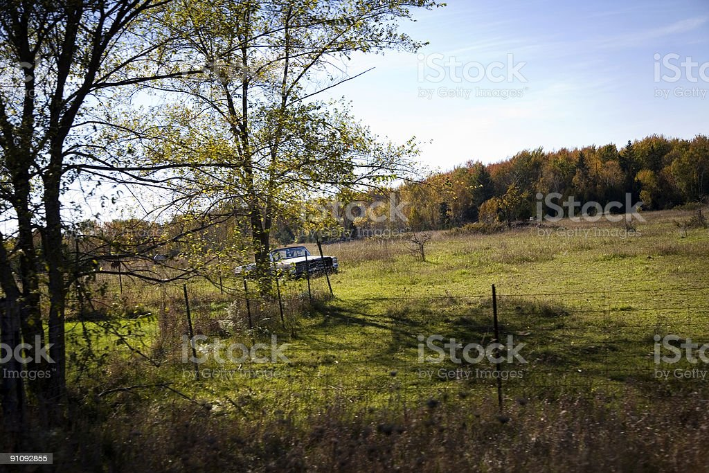 Abandoned Old Car in Field royalty-free stock photo