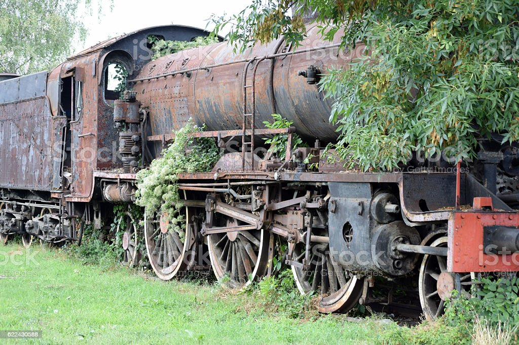 Abandoned old locomotive on the railroad siding stock photo