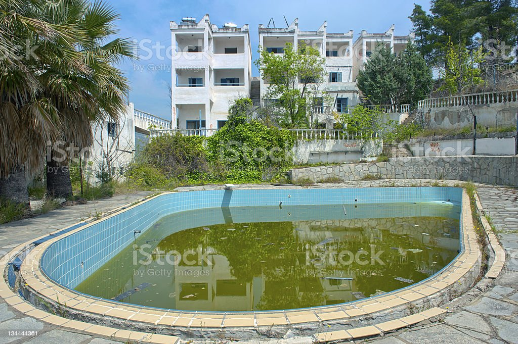 Abandoned pool amidst hotel ruins royalty-free stock photo