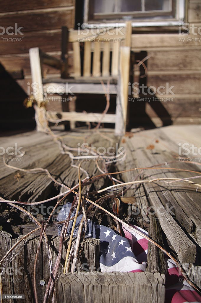 Abandoned porch with american flag, Virginia city, Nevada, USA stock photo