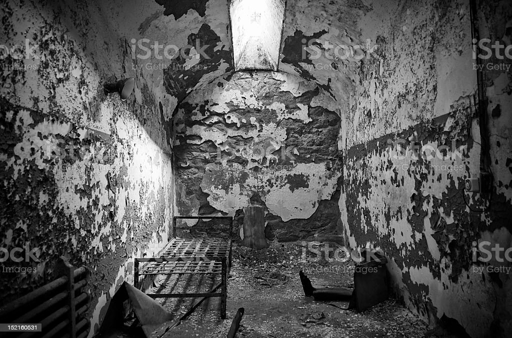 abandoned prison cell in black and white royalty-free stock photo