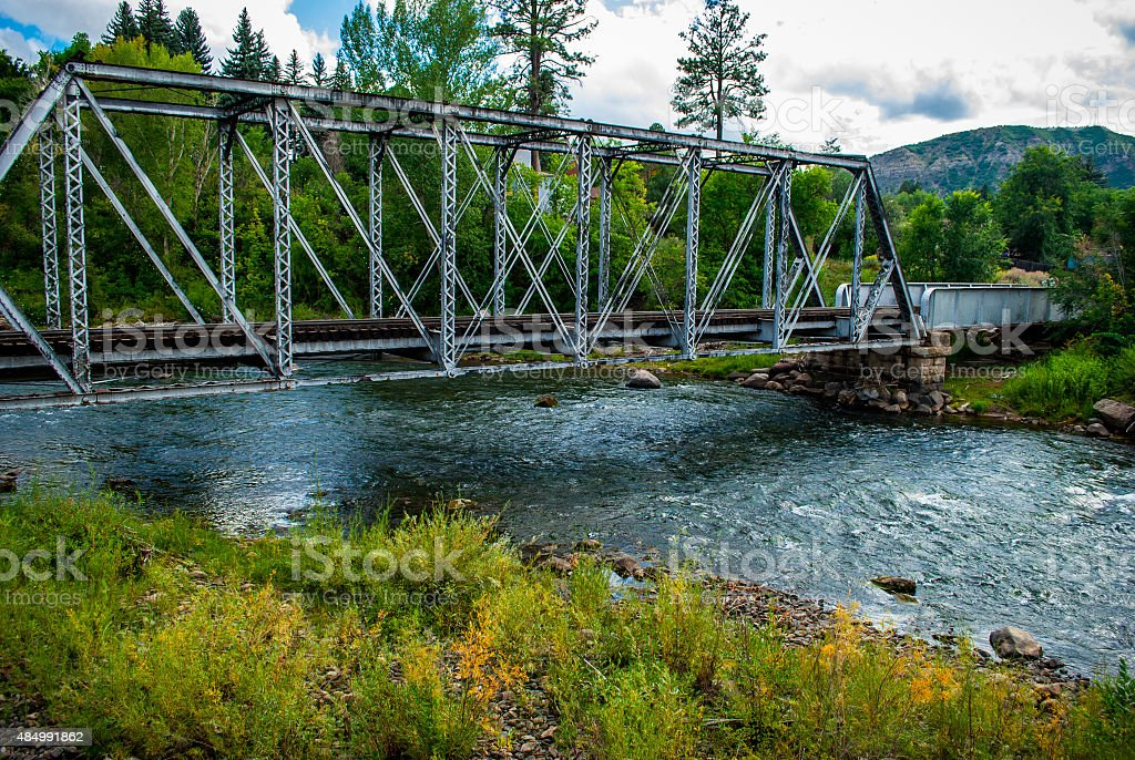Abandoned Railroad Bridge Over Clean Animas River Durango Colorado stock photo