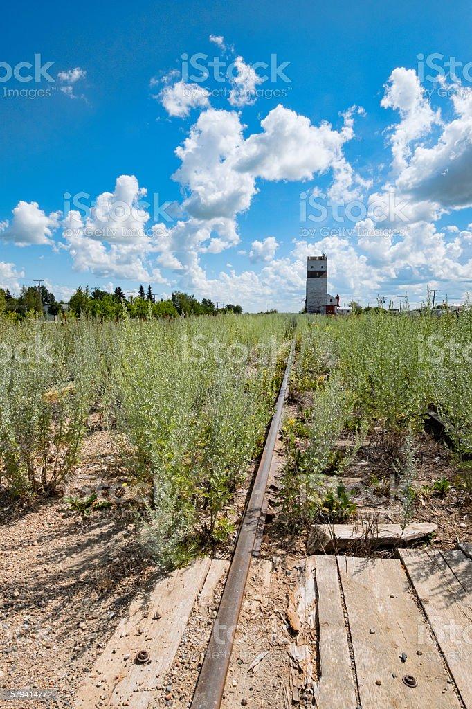 Abandoned Railway Tracks Leading to Grain Elevator stock photo