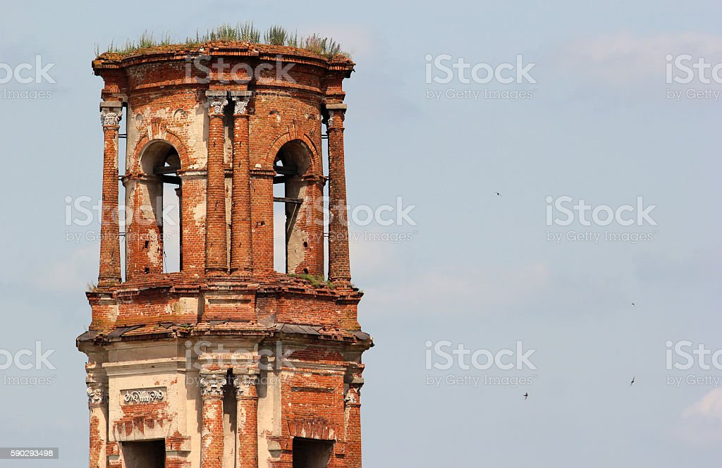 Abandoned red brick bell tower of old church stock photo