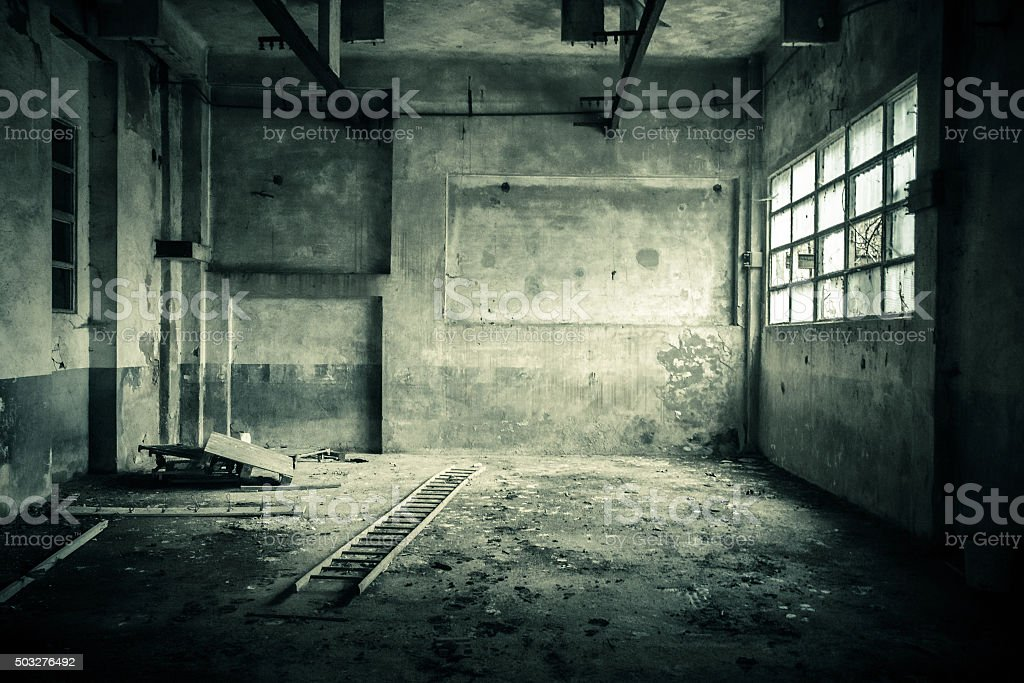 Abandoned room with broken window stock photo